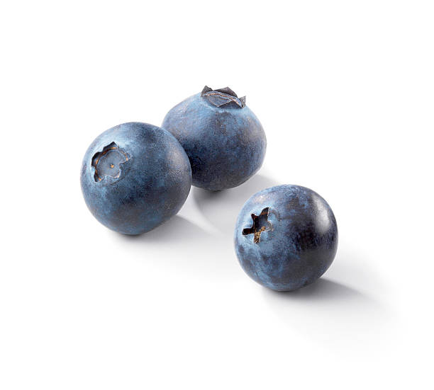 three blueberries on a white background - blueberry stock pictures, royalty-free photos & images