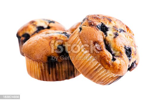 Stock photo of a stack of blueberry muffins isolated on a white background.