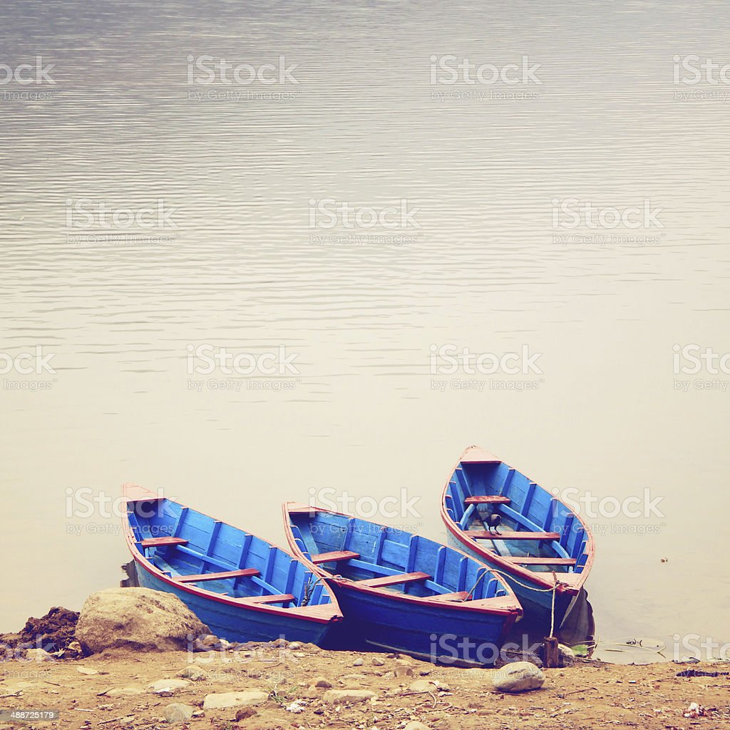 Three boats on the lake with retro filter effect stock photo