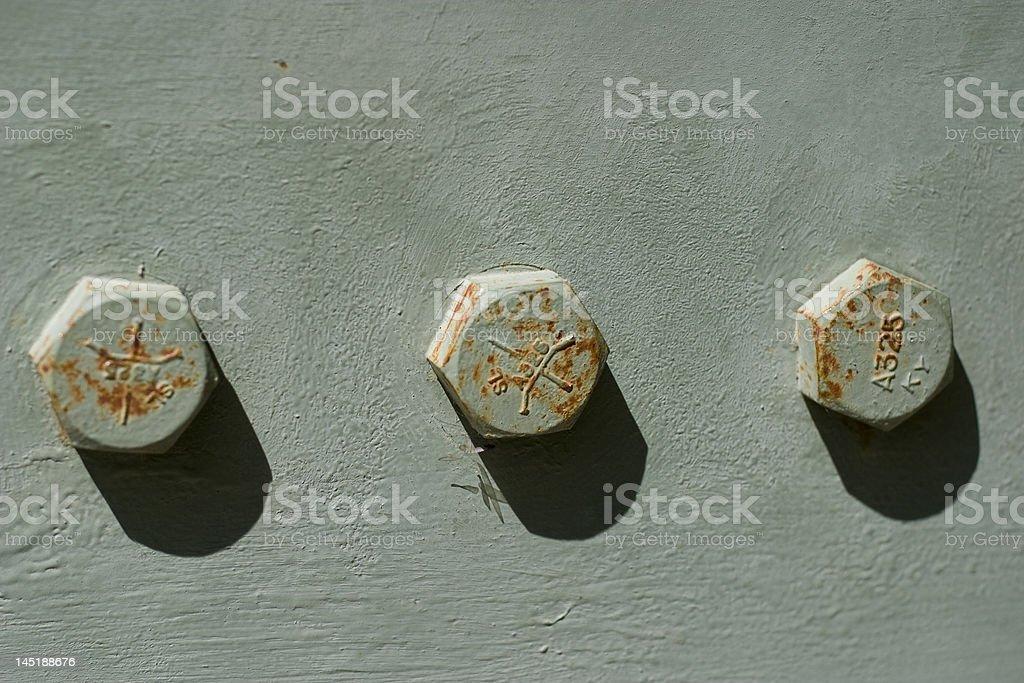 Three Bolt Heads royalty-free stock photo