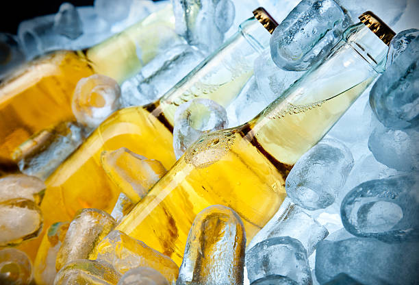 Three Bootles of Beer on Ice stock photo