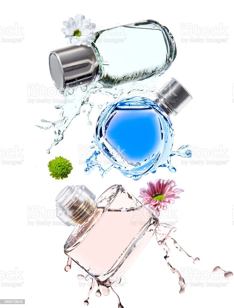 Three bottle of different colors perfumes stock photo