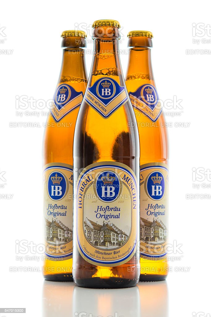 Three bottles cold light lager beer Bavarian Hofbrau Munich brewery stock photo