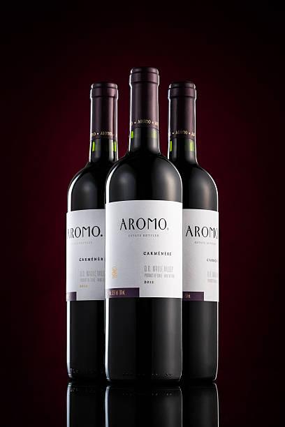 Three bottles of Aromo red wine stock photo