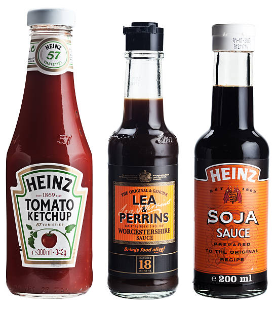 three bottles of popular sauces. - heinz stock photos and pictures