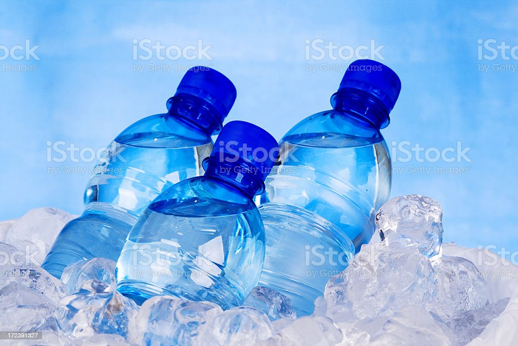 """Three bottles of water and ice """"Plastic bottles of water Taken in RAW,post processing with CS3"""" Blue Stock Photo"""