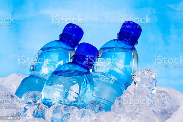 Three Bottles Of Water And Ice Stock Photo - Download Image Now