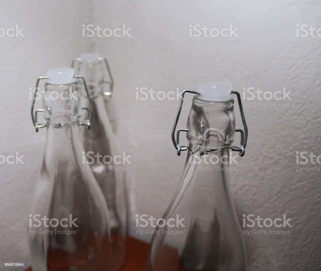 Three bottles staggered on a nightstand stock photo