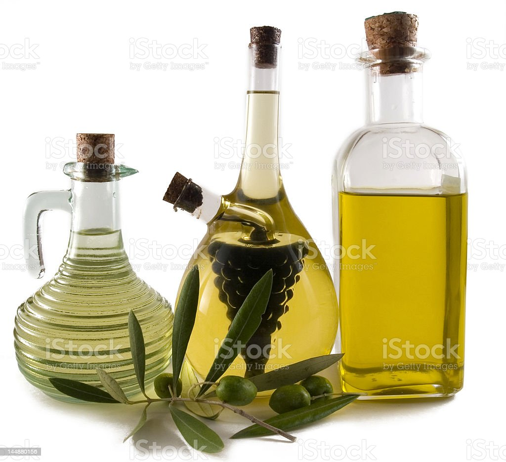 Three bottles with olive oil ,vinegar and olives royalty-free stock photo