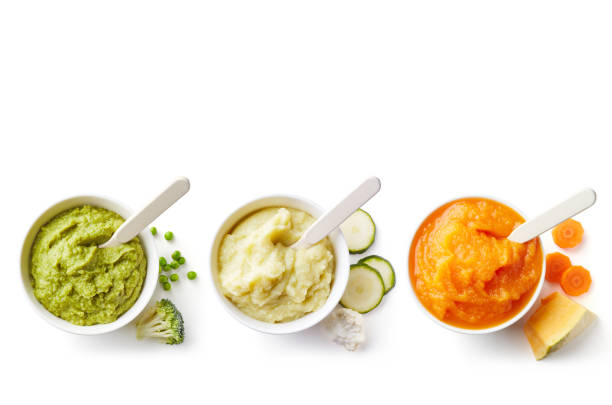three bowls of baby puree isolated on white from above - mash food state stock photos and pictures