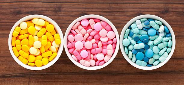 Three bowls with pills stock photo
