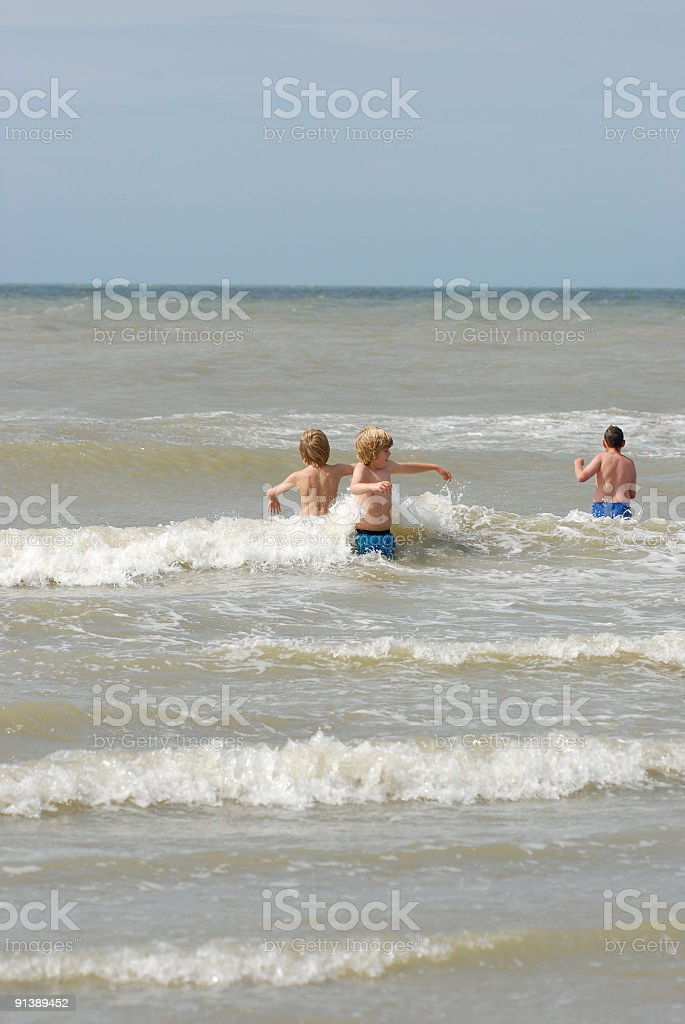 Three Boys in the surf royalty-free stock photo