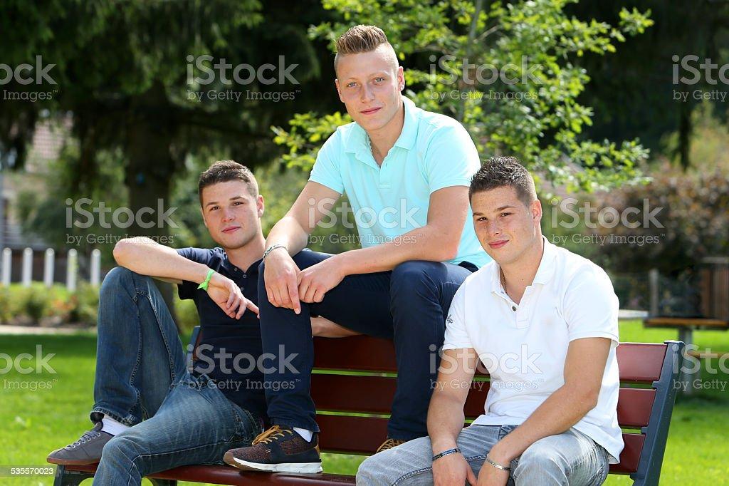 Three boys sitting stock photo