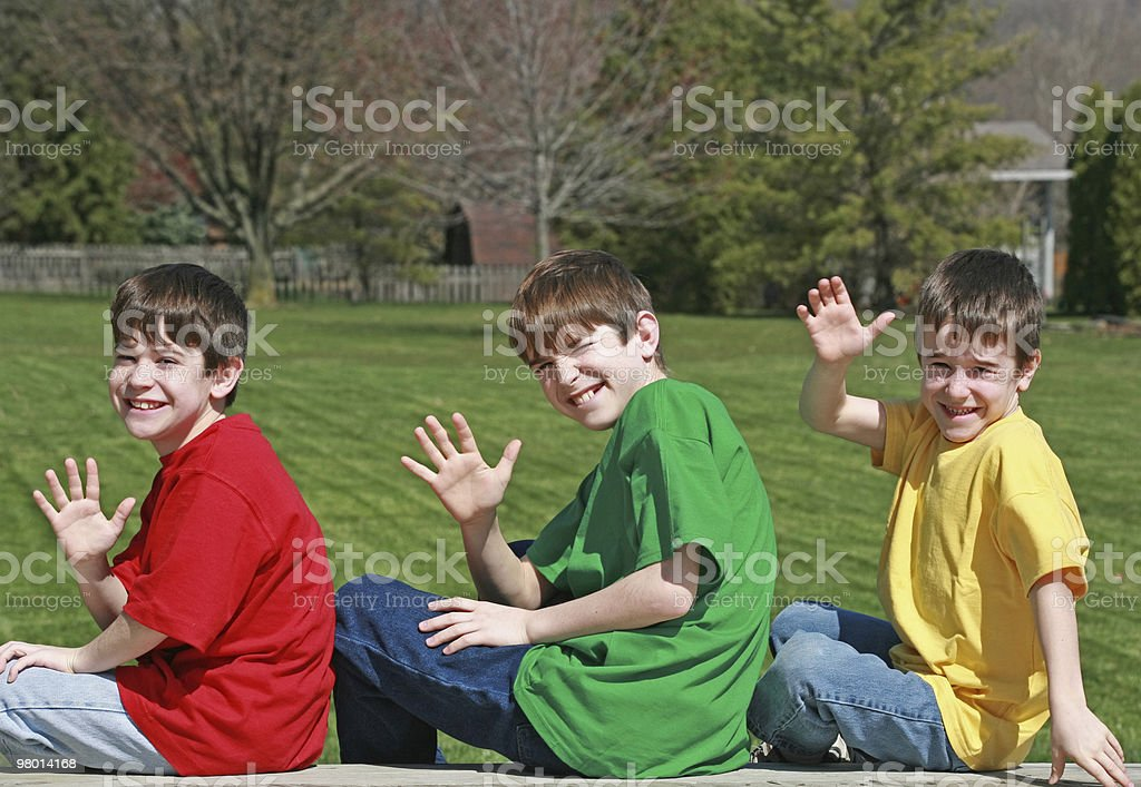 Three Boys Waving royalty-free stock photo