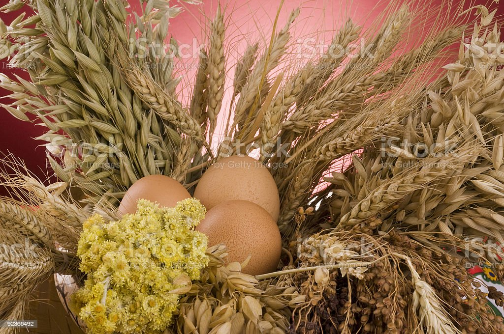 Three brown eggs in a bouquet of cereals. royalty-free stock photo