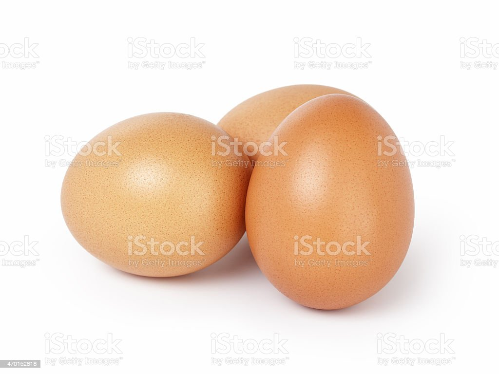 three brown eggs isolated stock photo