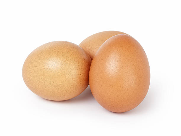 three brown eggs isolated - fresh start yellow stockfoto's en -beelden