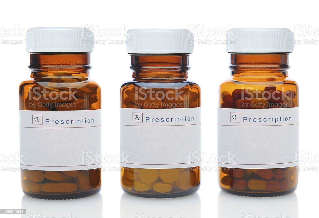 Three Brown Medicine Bottles With Different Drugs stock photo