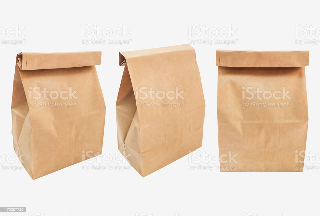 Three brown paper bags with tops folded over stock photo