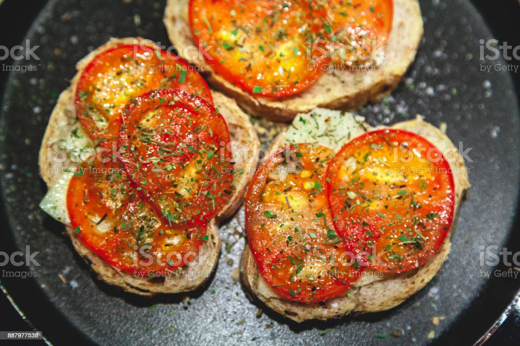 Three bruschettes with tomatoes lie on plate stock photo