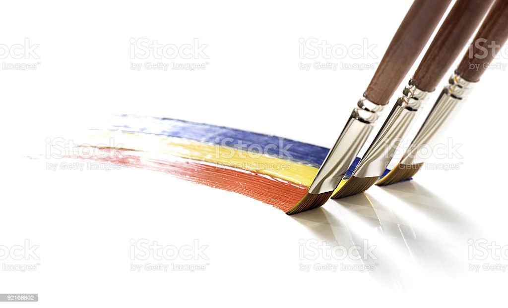 three brushes painting colors royalty-free stock photo