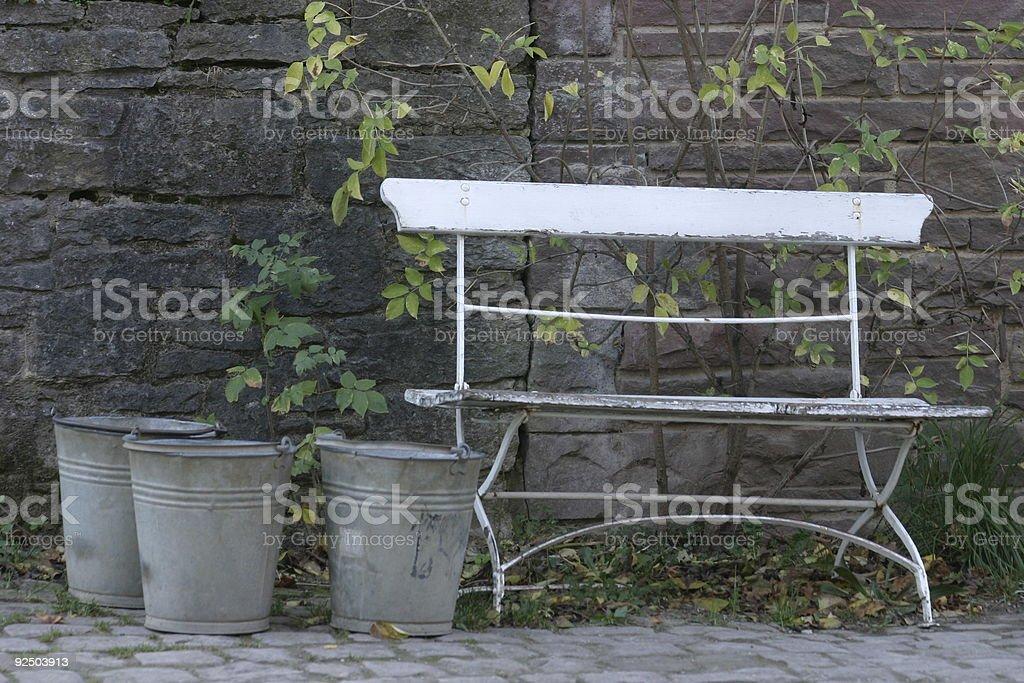 Three Buckets beside a bank royalty-free stock photo