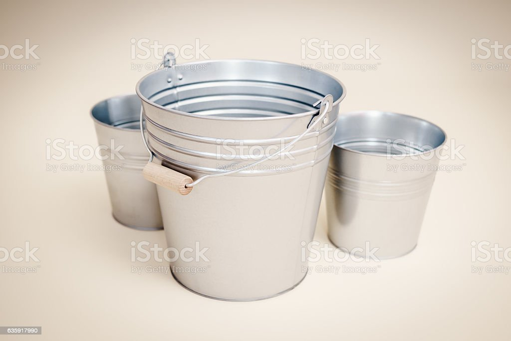 three buckets on a beige background stock photo