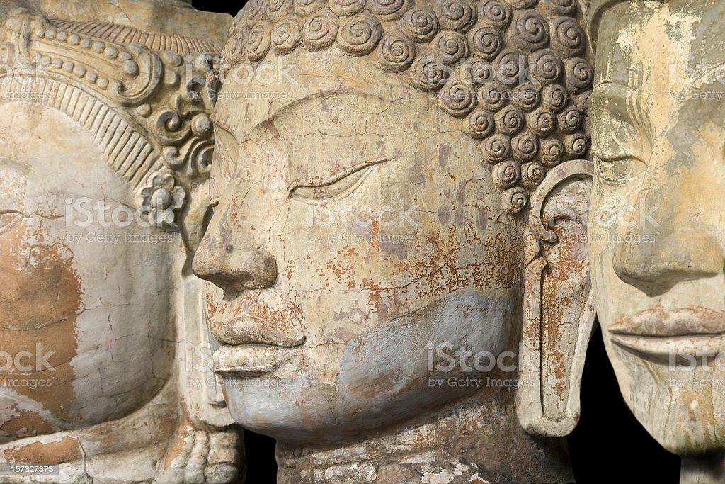 Three Buddha Faces in a Row stock photo