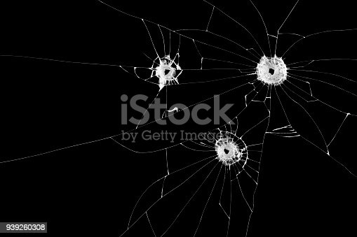 istock Three bullet holes on window isolated on black background. Cut out. 939260308