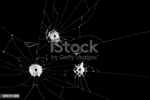 istock Three bullet holes on window isolated on black background. Cut out. 939261688