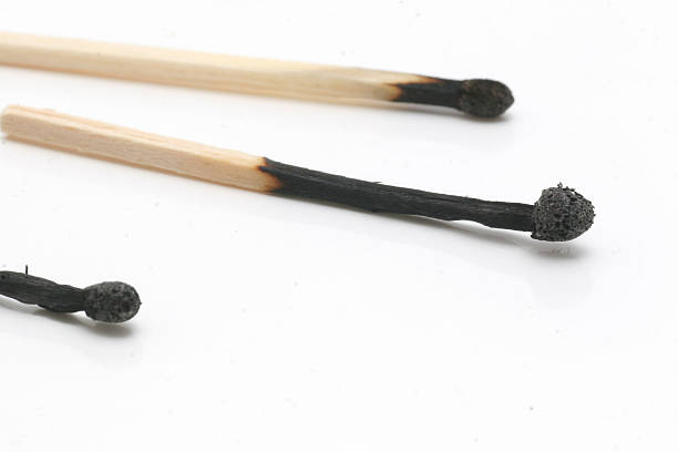 Three burned matches stock photo