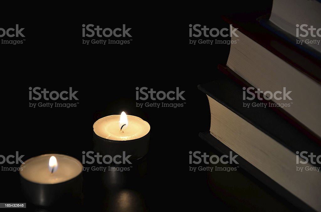 Three burning candles and old book royalty-free stock photo