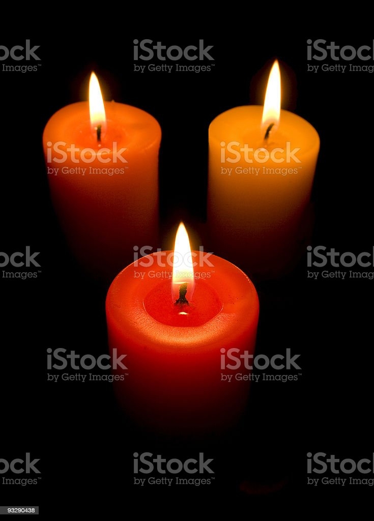 three burning candles, red, yellow, orange royalty-free stock photo
