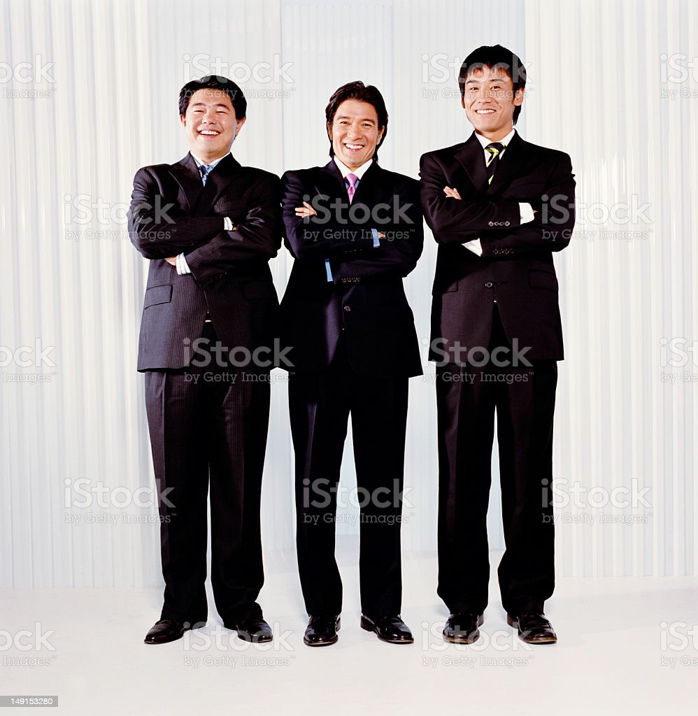 Three business executives, smiling, portrait royalty-free stock photo