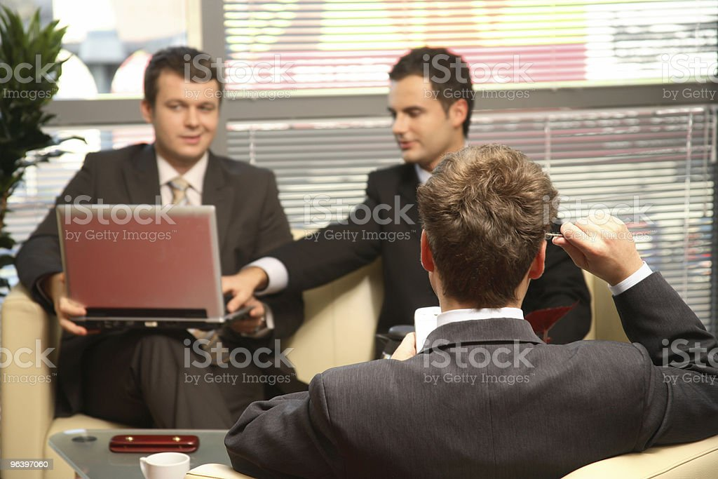 Three Business men working in the office royalty-free stock photo