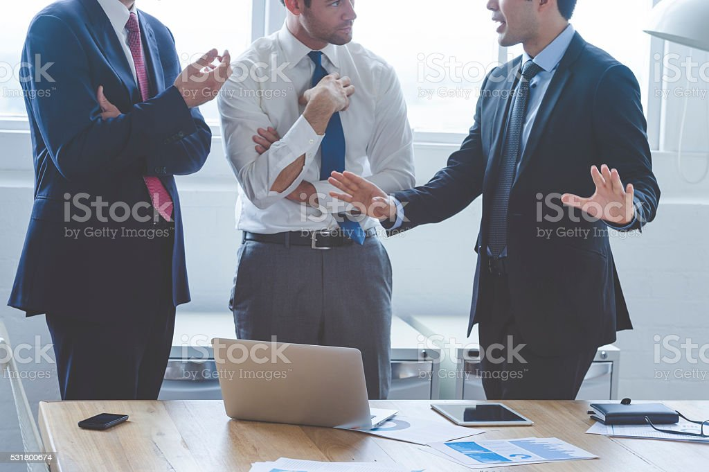 Three business people having a discussion. stock photo
