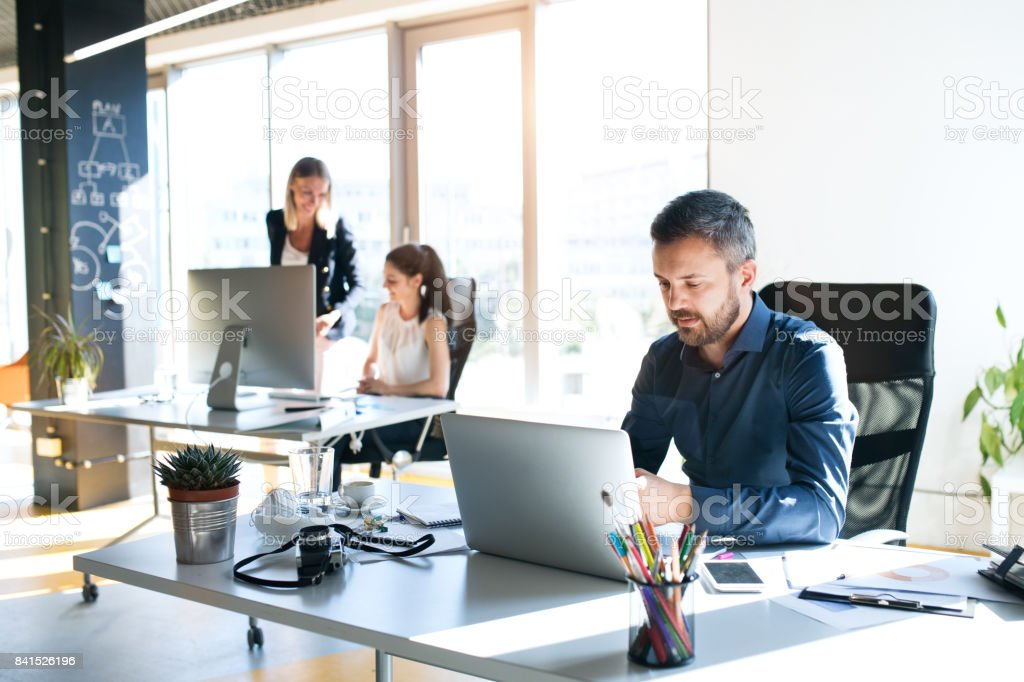 Three business people in the office working together. royalty-free stock photo