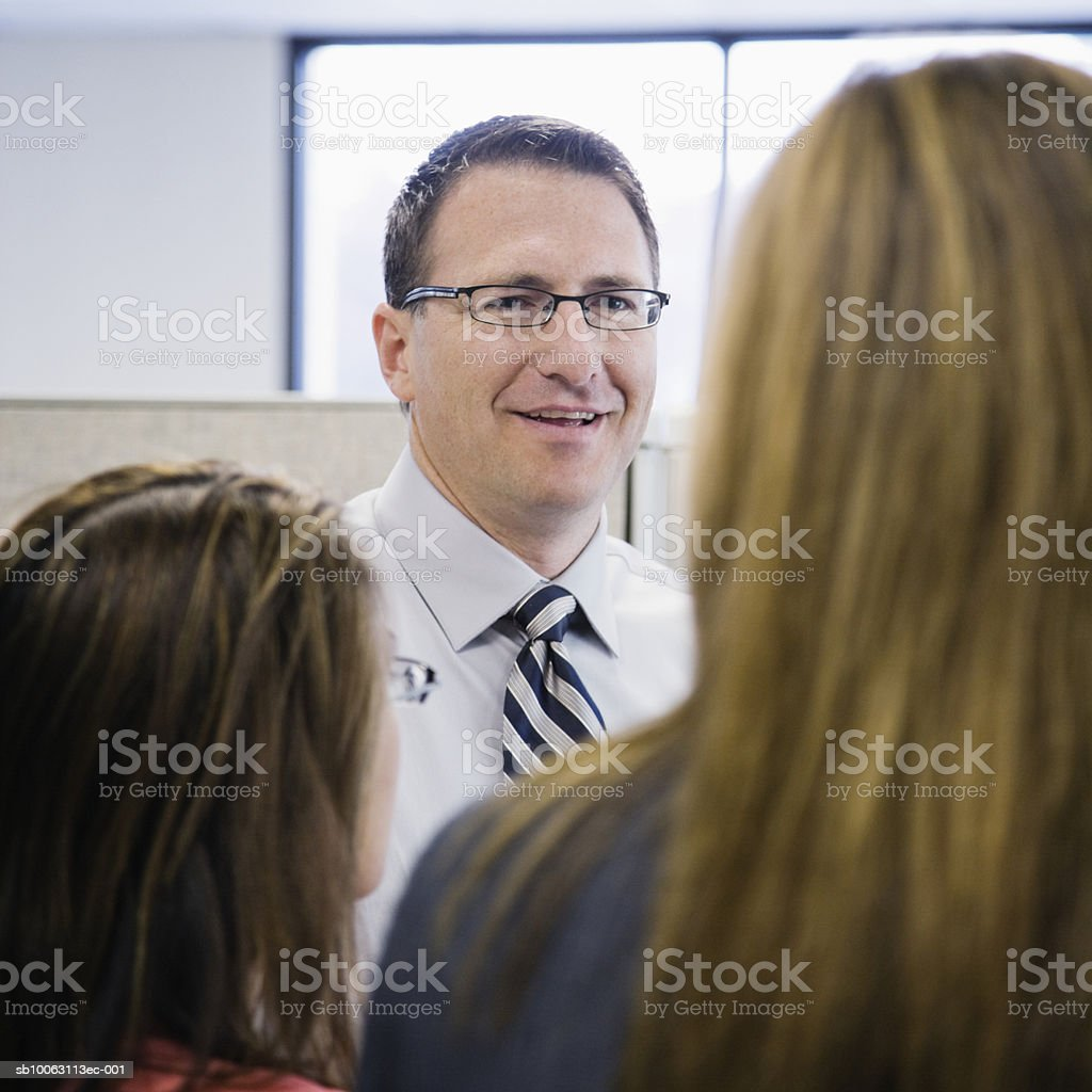 Three business people talking in office foto de stock royalty-free