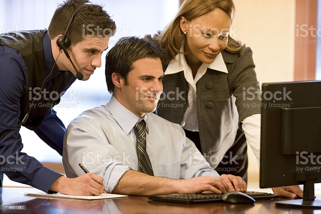 Three Business People Working Together royalty-free stock photo