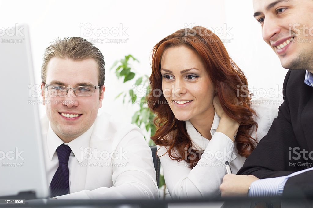 Three business people working together. royalty-free stock photo