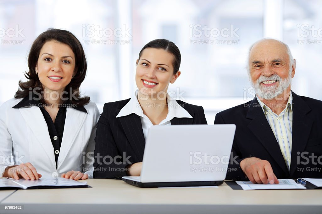 Three business people working together. royalty free stockfoto