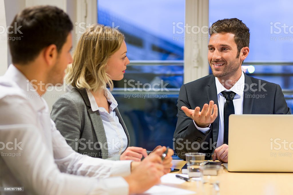 Three business peoples working together in meeting room royalty-free stock photo