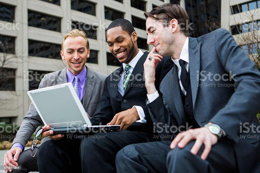 Three Businessmen and a Laptop royalty-free stock photo