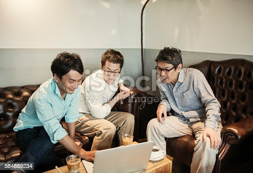 istock Three Businessmen meeting in a cafe 584889234