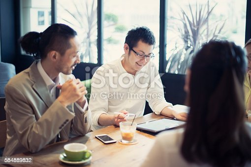 istock Three Businessmen meeting in a cafe 584889832