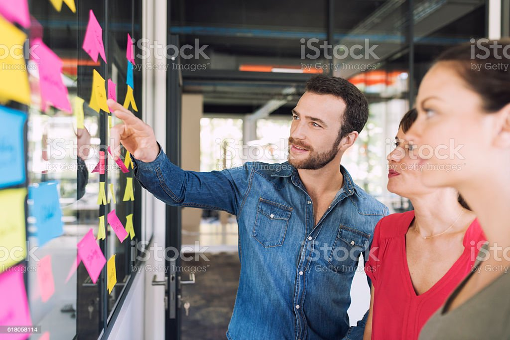 Three businesspeople discussing and planning concept stock photo