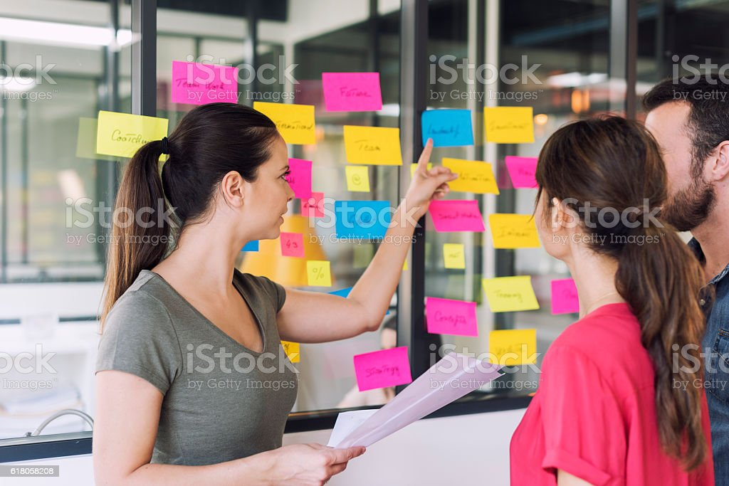 Three businesspeople discussing and planning concept – Foto