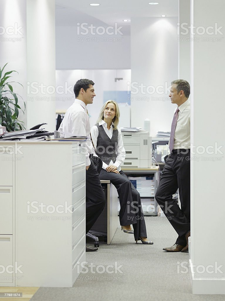 Three businesspeople in office 免版稅 stock photo