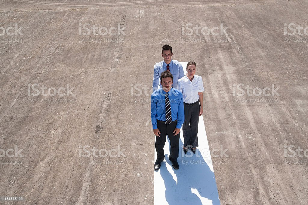 Three businesspeople standing on wall outdoors  royalty-free stock photo
