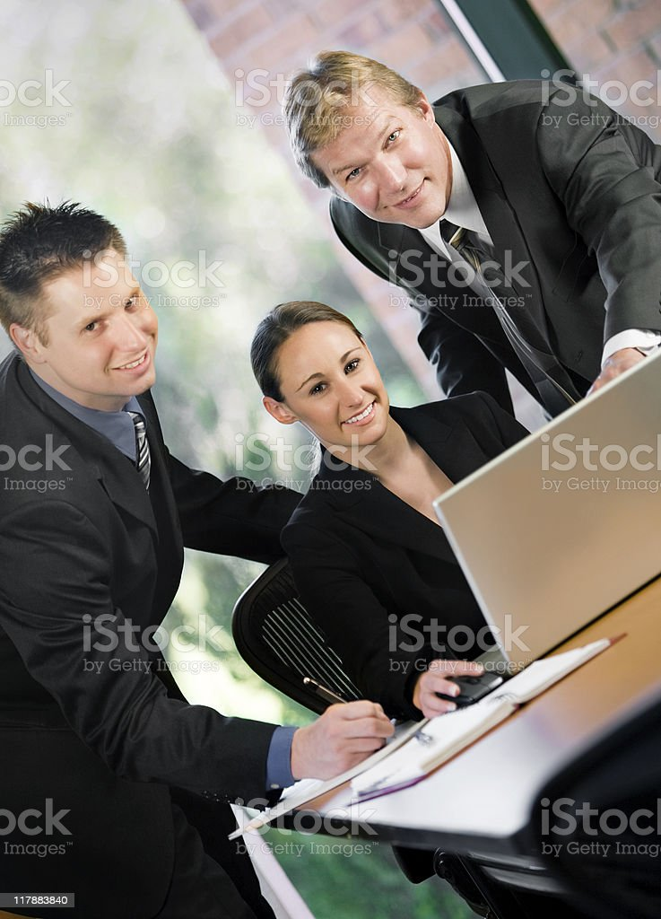 Three Businesspersons Looking At Laptop royalty-free stock photo
